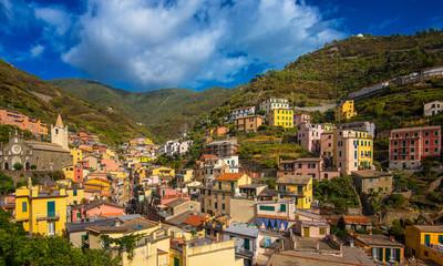 View on the colorful houses along the coastline of Cinque Terre area in Riomaggiore