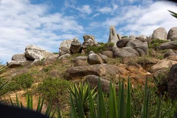 Farol Santa Marta. Laguna, Santa Catarina, BRAZIL - Mountain pebbles with view of a blue sky.