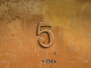 Number five on painted shining surface