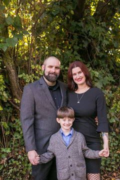 Portrait of smiling family standing in park