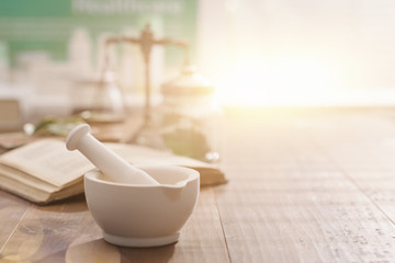 Tuinposter Apotheek Mortar and pestle on the pharmacist's table