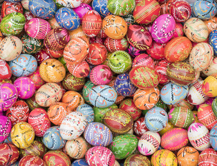 Basket full of traditional Polish, multi-colored, handpainted wooden Easter eggs