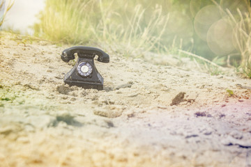 Retro phone. Photo Picture of an Old Phone on the Sand Beach. Beach of the lake