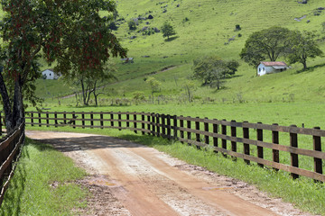 Rural landscape with fence and house