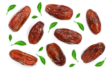 dry dates decorated with leaves isolated on white background. Top view. Flat lay pattern