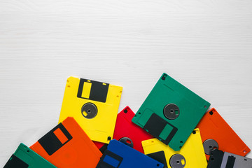 Vintage multi-colored floppy disk on white background