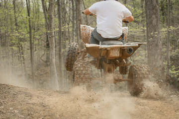 four wheeler driving up hill