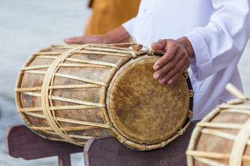 Man drumming in Indian wedding ceremonies, selective focus.