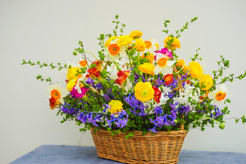 Summer bouquet with bright yellow and white flowers