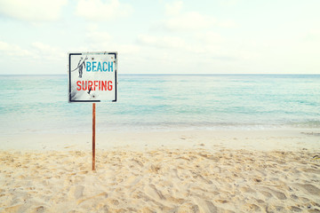 Fototapete - Tropical beach in summer. beach sign for surfing area. Vintage effect color filter.