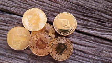 Ethereum cryptocurrency, litecoin and bitcoin on wooden background