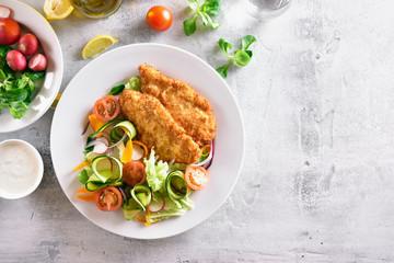 Vegetable salad and schnitzel