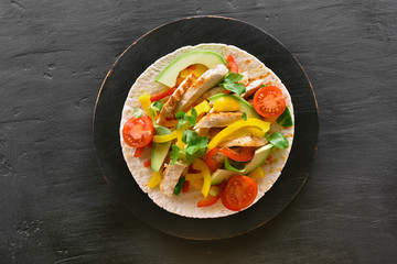 Taco with chicken meat and vegetables