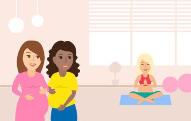 pregnant women in yoga class room