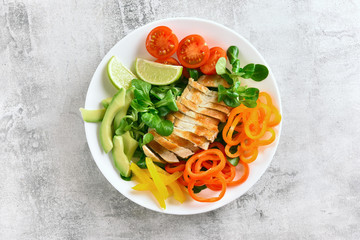 Healthy vegetable salad with grilled chicken breast