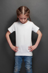 Kid girl wearing white t-shirt with space for your logo or design in casual urban style