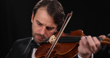 Musician Violinist Man Playing on Violin Instrument in Strings Orchestra a Classical Music Concert