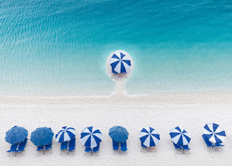 Competitive and business advantage concept as a group of sun umbrellas