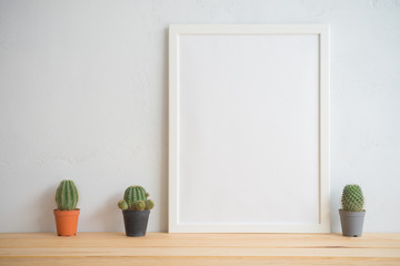 Photo frame and cactus pots mockup with white wall background, creative ideas slow life concept