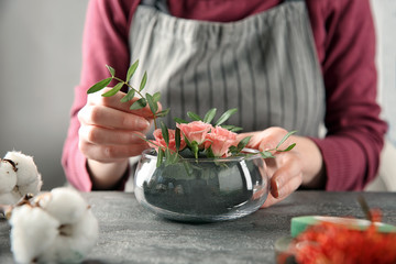 Female florist using sponge for work at table