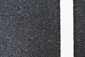 dirty white line on surface of old asphalt in countryside