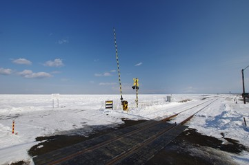 railway and railway crossing with drift ice in Hokkaido, Japan 流氷と釧網線踏み切り