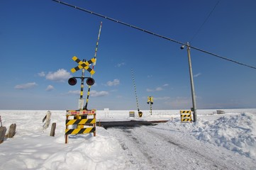 railway crossing with drift ice in Hokkaido, Japan 流氷と北浜駅踏み切り