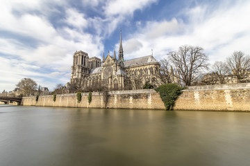 Long exposure photography of Notre Dame Cathedral from seine river - Paris