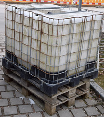 rainwater tank with a metal frame on a building site