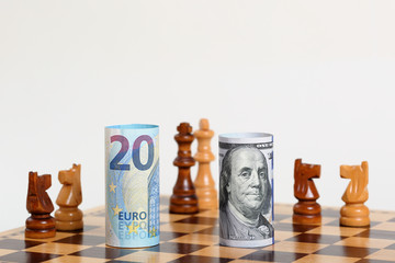 European Money Note vs US Money Note  on a Chess Board