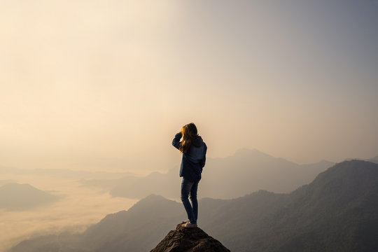 Young traveler standing and looking at beautiful landscape
