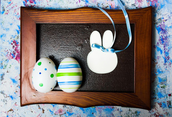 Colorful Ester eggs in a photo frame