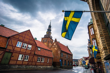 Ystad - October 22, 2017: Swedish national flag at the historic center of the town of Ystad in Skane, Sweden