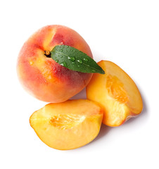 Peach with leaves.