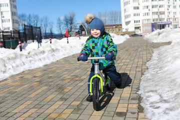 Child riding on balance bike