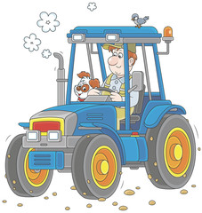 Smiling worker driving his wheeled tractor