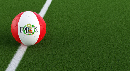 Soccer ball in Peru´s national colors on a soccer field. Copy space on the right side - 3D Rendering