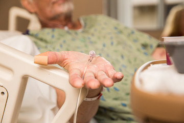 Elderly Hospital Patient Holding Hand Out