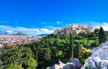 Fotomurales - Acropolis with Parthenon with the hill of Lycabetus and nice clouds, Greece.