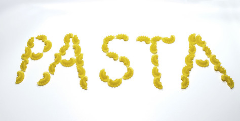 A word of pasta made from macaroni pasta on a white background. Healthy diet and lifestyle.