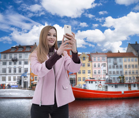 woman is making selfies.