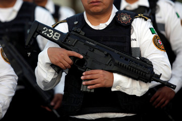 Mexican state police hold Beretta ARX160 rifles in Monterrey