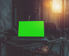 laptop with a green screen close up
