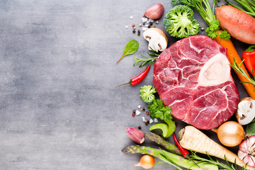 Raw fresh meat Ribeye Steak with vegetables and spice.