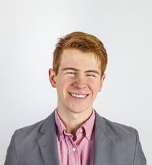 portrait of attractive laughing smiling boy in puberty