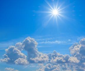 blue cloudy sky with sparkle sun