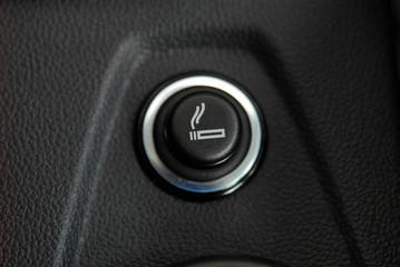 The Car cigarette lighter in a car interior