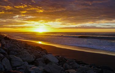 Sun sets on the West coast of New Zealand
