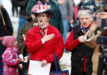 """People recite the pledge allegiance before a """"March For Our Guns"""" rally at the state capitol in Helena, Montana"""