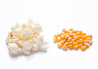 Raw golden sweet corn and popcorn seeds on white
